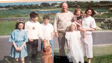 Jack Charlton with the Kerins family. L-R: Anita, Mark, Alan, JC, Elaine in communion dress, Miriam being held by mother Anne.