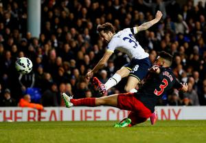 Ryan Mason shoots past Neil Taylor to put Tottenham back in the lead