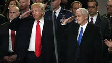 US President Donald Trump (L) and Vice President Mike Pence salute during the Inaugural Parade from the main reviewing stand in front of the White House on January 20. Photo: Getty Images