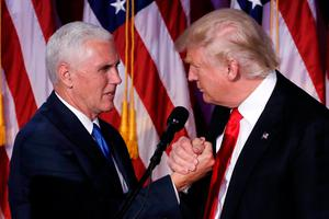 U.S. President-elect Donald Trump and Vice President-elect Mike Pence embrace at their election night rally in Manhattan, New York, U.S., November 9, 2016. REUTERS/Mike Segar