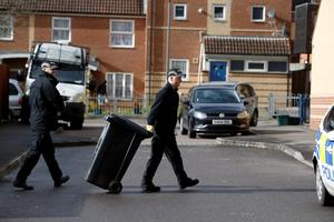 """Avon and Somerset police search around Barton Court in Bristol for missing teenager Rebecca Watts. PRESS ASSOCIATION Photo. Picture date: Tuesday March 3, 2015. Detective Superintendent Mike Courtiour said in a statement: """"As a result of new information received late last night, we attended a house at Barton Court in the Barton Hill area of Bristol. """"The information suggested that Becky's body had been cut up and a search at the new location resulted in the discovery of body parts. See PA story POLICE Missing. Photo credit should read: Steve Parsons/PA Wire"""
