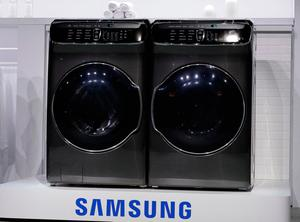 The FlexWash and FlexDry are unveiled during a Samsung news conference before CES International, Wednesday, Jan. 4, 2017, in Las Vegas. (AP Photo/John Locher)
