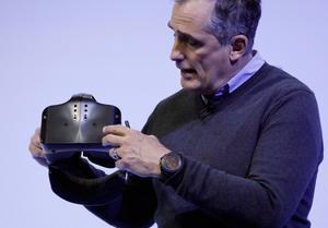 Intel CEO Brian Krzanich holds a Project Alloy all-in-one merged reality headset during an Intel news conference before CES International, Wednesday, Jan. 4, 2017, in Las Vegas. (AP Photo/John Locher)