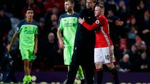 Liverpool manager Jurgen Klopp and Manchester United's Wayne Rooney after the game