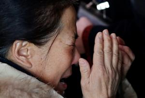 A relative of a passenger onboard Malaysia Airlines flight MH370 cries at the Beijing Capital International Airport in Beijing March 8, 2014.  REUTERS/Kim Kyung-Hoon
