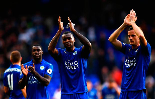 Wes Morgan (C) and Leicester City players applauds away supporters after his team's 1-1 draw. Photo: Getty