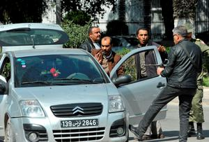 Armed Tunisian policemen in plainclothes stop a vehicle as security forces secure the area after gunmen attacked Tunis' famed Bardo Museum on March 18, 2015. AFP PHOTO / FETHI BELAIDFETHI BELAID/AFP/Getty Images