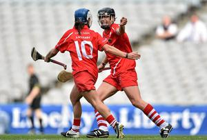 Jennifer O'Leary, left, celebrates with team-mate Angela Walsh after Walsh scores Cork's second goal. Picture credit: Ramsey Cardy / SPORTSFILE