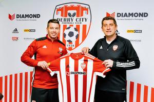 Adam Hammill, left, is pictured with Derry City manager Declan Devine after signing a short-term deal with the Candystripes