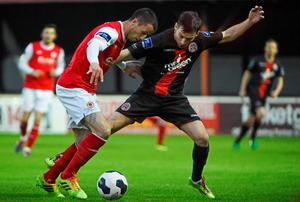 St Patrick's Athletic's Keith Fahey looks to get the better of Karl Moore of Bohemians in the FAI Ford Cup quarter-final at Richmond Park. Photo: Pat Murphy / SPORTSFILE