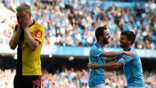 TOPSHOT - Manchester City's Portuguese midfielder Bernardo Silva (C) celebrates with Manchester City's Spanish midfielder David Silva (R) after he scores the team's seventh goal during the English Premier League football match between Manchester City and Watford at the Etihad Stadium in Manchester, north west England, on September 21, 2019. (Photo by Oli SCARFF / AFP)