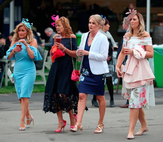 Racegoers arriving during day one of the 2018 Randox Health Grand National Festival at Aintree Racecourse, Liverpool