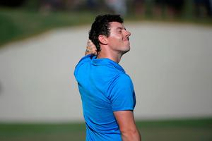 Rory McIlroy reacts after making a bogey on the 18th green