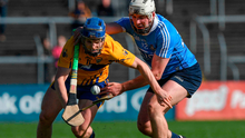 Podge Collins of Clare in action against Dómhnall Fox of Dublin