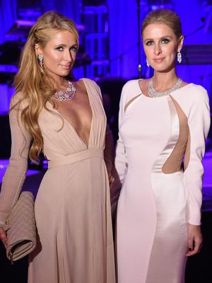 Paris Hilton and Nicky Hilton attend Angel Ball 2014 hosted by Gabrielle's Angel Foundation at Cipriani Wall Street