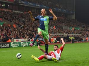 Newcastle's Gabriel Obertan battles for the ball with Stoke City's Marc Wilson. Photo credit: Martin Rickett/PA Wire