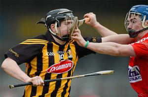 Kilkenny's Walter Walsh gets some close attention from Conor O'Sullivan of Cork during the Allianz NHL Division 1A game at Nowlan Park