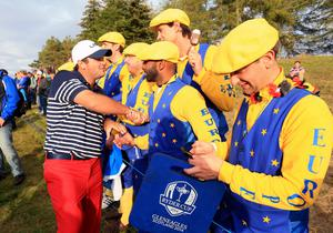 USA's Patrick Reed shakes hands with some Europe fans during the Singles matches on day three of the 40th Ryder Cup at Gleneagles Golf Course, Perthshire. PRESS ASSOCIATION Photo. Picture date: Sunday September 28, 2014. Photo credit should read: Mike Egerton/PA Wire. RESTRICTIONS: Use subject to restrictions. Editorial use only. No commercial use. Call +44 (0)1158 447447 for further information.