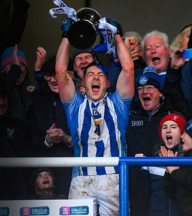 Ryan Basquel lifts the trophy following Ballyboden's AIB Club SF Championship Final win over between Eire Óg of Carlow. Photo: Sportsfile