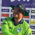 Paul Stirling receives his man of the match award in Grenada yesterday