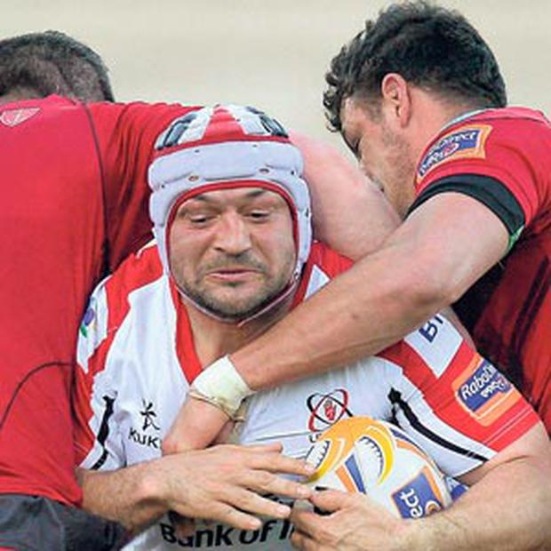 Ulster's Rory Best is tackled by Scarlets duo Rob McCusker, left, and Aaron Shingler during last night's Pro12 play-off