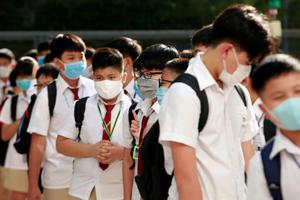 Plan: Children in Vietnam have already returned to the classroom wearing masks. Picture: Reuters