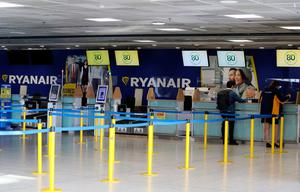 An almost deserted Ryanair check-in desk at Dublin Airport
