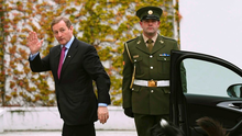 Taoiseach Enda Kenny arrives at Áras an Uachtaráin to receive his seal of office from Michael D Higgins, watched by the President's pet dogs Photo: REUTERS/Clodagh Kilcoyne