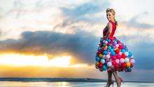 Karen Koster wearing a dress made from hundreds of coloured balloons inspired by Special K's new Live in Colour campaign