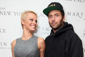 (L-R)Pamela Anderson and Rick Salomon attend The Martin Katz Jewel Suite Debuts At The New York Palace Hotel