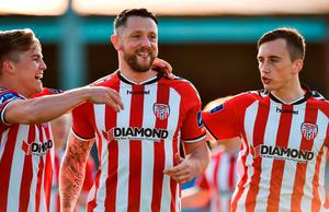 Rory Patterson celebrates after putting Derry City in the lead with team-mates Josh Daniels, left, and Aaron McEniff. Photo by Paul Mohan/Sportsfile