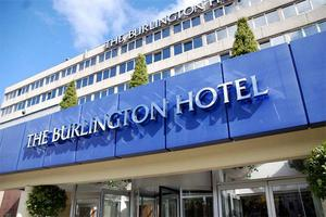 THE manager of Ireland's Aga Khan showjumping team escaped unhurt after an explosion in the fridge in his room at the Burlington Hotel in Dublin.