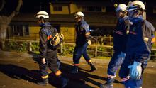 Rescue workers walk through the streets after a large earthquake in Concon, some 110 kms northwest of Santiago on September 16, 2015. The 8.3-magnitude earthquake that struck off the coast of Chile has left at least five dead, a million evacuated and one person missing, an official said. AFP PHOTO/ VLADIMIR RODASVLADIMIR RODAS/AFP/Getty Images