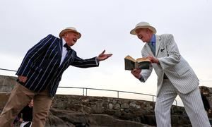 Bloomsday 2020. Michael Chester and Peter Caviston with his copy of Ulysses at the Forty foot in Sandycove.  Picture; Gerry Mooney