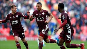 Leicester City's Youri Tielemans (centre) celebrates scoring