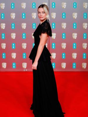 Australian actress Margot Robbie poses on the red carpet upon arrival at the BAFTA British Academy Film Awards at the Royal Albert Hall in London on February 2, 2020. (Photo by Tolga AKMEN / AFP)