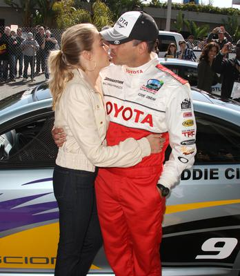 LONG BEACH, CA - APRIL 14: Recording artist LeAnn Rimes (L) kisses Eddie Cibrian during the 36th Annual Toyota Pro/Celebrity Race at the Long Beach Grand Prix on April 14, 2012 in Long Beach, California.  (Photo by Frederick M. Brown/Getty Images)