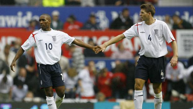 Jermain Defoe (L) of England and Steven Gerrard playing for England against Andorra on September 2, 2006 (Photo by Clive Mason/Getty Images)