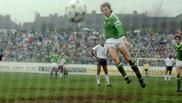 David Kelly scores from the penalty spot in a 4-1 win over England B at Turners Cross in March 1990