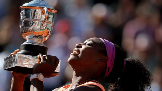 Serena Williams of the U.S holds the cup after defeating Lucie Safarova of the Czech Republic during their final match of the French Open