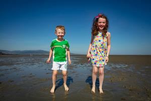 Cormac Toner, age 4 and his sisterNiamh, age 7, Dromiskin, enjoying the heatwave at Blackrock beach in Co Louth. Picture:Arthur Carron