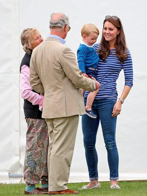 TETBURY, ENGLAND - JUNE 14:  Prince Charles, Prince of Wales talks to his grandson Prince George of Cambridge with Catherine, Duchess of Cambridge at the Gigaset Charity Polo Match at Beaufort Polo Club on June 14, 2015 in Tetbury, England.  (Photo by Chris Jackson/Getty Images)