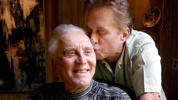 Michael Douglas kisses his film legend father during a photo session in Beverly Hills, California. Photo: AP Photo/Chris Pizzello