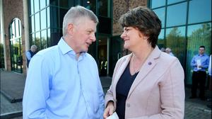 Solidarity: DUP leader Arlene Foster chats with Kevin Lunney's brother Tony at the Quinn Industrial Holdings rally in support of the injured man. Photo: Steve Humphreys