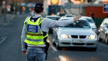 FILE PHOTO: A police officer is seen on the streets of Dublin as the spread of the coronavirus disease (COVID-19) continues, Dublin, Ireland. REUTERS/Jason Cairnduff/File Photo