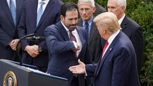 Elbow first: Bruce Greenstein, executive of healthcare company LHC, offers Donald Trump an elbow bump. PHOTO: REUTERS