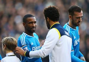Jermain Defoe is welcomed back to White Hart Lane by former team-mate Moussa Dembele