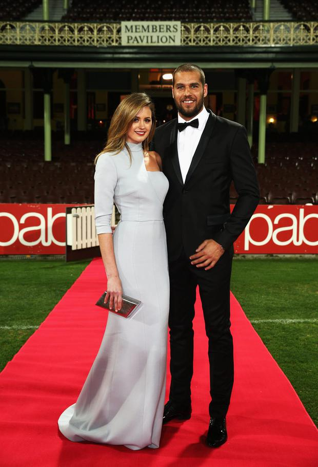 Lance Franklin of the Swans and partner Jesinta Campbell arrive ahead of the Sydney Swans official Brownlow Medal function at Sydney Cricket Ground