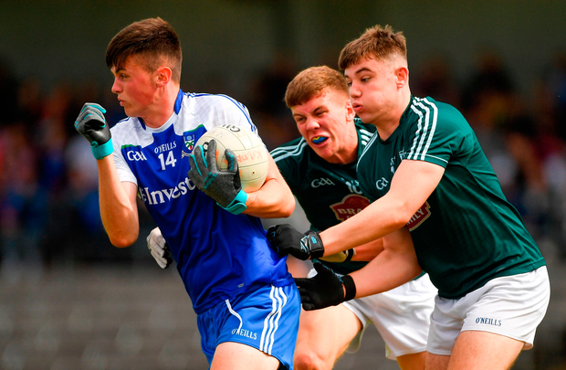 Loughlinn Power of Monaghan in action against Jack Cleary, centre, and Conor McGroarty of Kildare. Photo by Piaras Ó Mídheach/Sportsfile