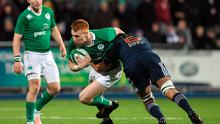 Ciaran Frawley of Ireland is tackled by Dylan Cretin of France
